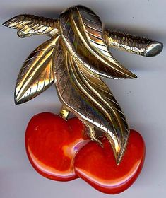 Vintage Bakelite and metal cherry brooch.