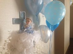 Beautiful centerpiece for you christening or presentation celebration with a baby angel seated  in a bed of blue or pink roses on top of a 10 inch white column .This piece ... #designsbydazey