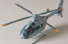 """Helicopter Eurocopter EC 135 Paper Model - by NurHelis - == - This is the Helicopter Eurocopter EC 135, in a beautiful and easy-to-build paper version created by NurHelis German website. There are more two paper models of Eurocopters by NurHelis and you will find the links to download both at the end of this post, in the """"related links""""."""