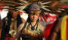 A woman dressed in indigenous attire participates in a ceremony outside the Museum of Mexican History in Monterrey, Mexico.