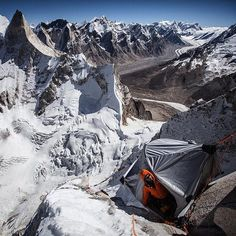 Photo by @jimmy_chin / @merufilm  Not all camps are created equal. After 6 days on the mountain @renan_ozturk crawls out of the hanging portaledge at 18000ft and takes in the daunting upper head wall of the Sharks Fin on Mount Meru one of the most notorious routes in the Himalaya. See what happens next in @merufilm winner of the the 2015 Sundance Audience Award coming out in theaters nationwide August 14. Give a follow at @merufilm or check merufilm.com for a theater near you. #friendship…