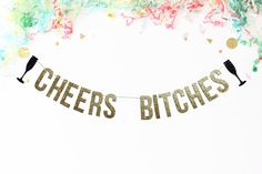 Black and gold glitter Cheers Bitches banner.  Specs: *Banner is available in your choice of 4 different sizes *Letters are adjustable along white string *Glitter card stock is professional quality, 300gsm weight *Duo-toned glitter for maximum sparkle *Backed with sturdy white card stock  **Looking to create your own custom banner? https://www.etsy.com/listing/277568400/custom-banner-wedding-decor-birthday?ref=shop_home_active_9  **Current processing time and shipping options: Creation time…
