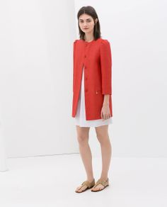 Image 1 of COAT WITH GATHERING ON THE SHOULDER from Zara