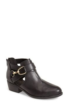 Free shipping and returns on Topshop 'Bernie' Cutout Bootie (Women) at Nordstrom.com. With its eye-catching goldtone hardware and cutout shaft, this round-toe boot is a modern classic in the making. A back zip closure ensures easy on and off, while a sturdy stacked heel offers a bit of height with walkable restraint.