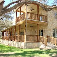 Texas ranch house - I love the wrap around porch with fans. I can picture really cool bright colored western furniture and accents in here