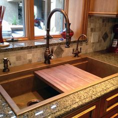Love the idea of a (removable) cutting board nestled in the sink.  Clean up would be SO much easier!