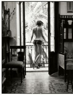 Great composition for a black and white photograph. The large space in the room is just as important as the woman. -A Sicilian Adventure: Bambi Magazine
