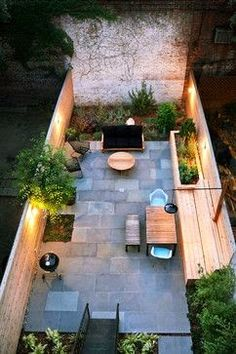 16 Ways to Get More from Your Small Backyard.... Love the urban landscape look and the lighting here. Feels very natural and simple....