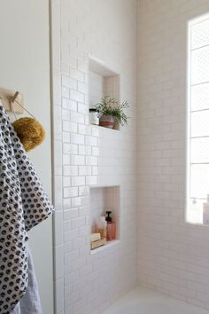 Simple White subway tile bathroom // Jillian Harris New House Inspiration love the niches
