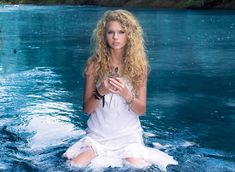 Taylor Swift wearing a white dress in the water
