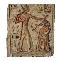 This block is decorated with a traditional scene representing King Ramesses the Second massacring his enemies. He wears a complete, elegant costume; the Blue Crown adorned with the uraeus, the collar called usekh, an elaborate garment, two armlets, two bracelets and sandals.   He holds, in his left hand, three prisoners by their hair while in his right hand he holds an axe with which he is about to strike them. The facial features, the hairstyle and the beards of the enemies indicate that…