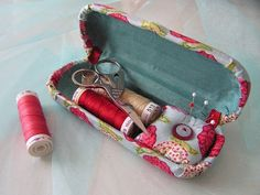 Create a sewing kit from an eyeglass case. Great to tuck away in your car, for camping or to take on your trips.