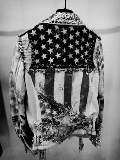 Stars and stripes rocking with studs and bleach! Not sure if this is a leather or denim jacket, but either way it's an amazing DIY inspiration!