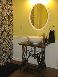 Last summer's DIY project...converted an old singer sewing machine base into a sink base.