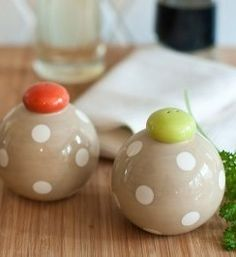 Spice up your table décor with these stylish Neutral Dot Salt and Pepper Shakers. The neutral palette will compliment any tableware and the round shape is distinctive and easy to use.