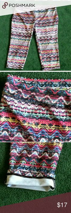 Tribal Spandex Capris Multi color tribal pattern capris for Zumba or gym, knew length, shades of blue, white fuscia, drop of yellow. Junior size XL. Looks fab under blue tunic or mini dress with cute heels. 88% polyester 12% spandex.  Condition is like new. MJS Pants Capris