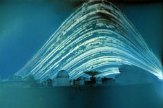 From solstice to solstice, this six month long exposure compresses time from the 21st of June till the 21st of December, 2011, into a single point of view. Dubbed a solargraph, the unconventional picture was recorded with a pinhole camera made from a drink can lined with a piece of photographic paper.