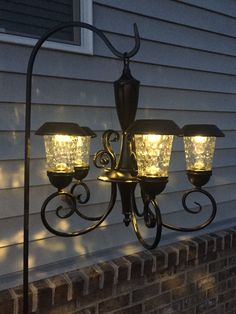 Solar Chandelier  Retrofitted solar garden lights into old chandelier.  Spray painted oil rubbed bronze