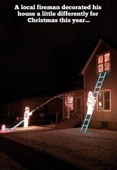 christmas lights decorations by firefighters  | Funny Christmas Pictures | www.FunnyChristmas.com