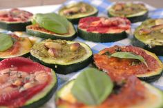 Mini zucchini pizzas! Start with tomato or pesto sauce. Then add cheese, salami, pine nuts. Broil for 3-5 minutes. After that, top with fresh basil leaves!