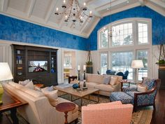 I adore the ceiling height, the large windows, the white millwork....the furniture layout....the floors....I'd go a bit lighter on the blue!