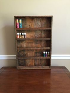 Wall shelf to hold essential oils or nail polish. It is roughly 16x24x3 and has 5 shelves. Holds +-90 5ml bottles or 70 15ml bottles of Young Living essential oils. Hand made from refurbished wood so these are rough estimates depending on what wood we have in stock. The shelf includes a lip to hold the oils on the shelf. Contact me for a quote on custom orders - I can make many different sizes. *Please note the essential oils pictured are not included with purchase. I will be happy to make…