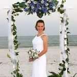 The large floral entity just over the bride's head seems to distract rather than enhance