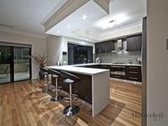 Modern u-shaped kitchen design using floorboards - Kitchen Photo 329215  check out ceiling