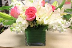 White lilies, stock and pink roses