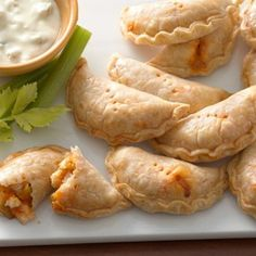 Have you tried empanadas before? They're lovely little pockets of meat, veggies and cheese wrapped up in simple savory dough. These bite-size buffalo empanadas are downright addictive! Just add blue cheese or ranch dressing.