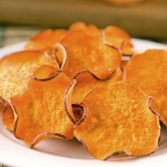 Sweet Potato Chips slice sweet potatoes thinly on a mandolin slicer, toss the slices in one teaspoon of olive oil, lay them out on a cookie sheet, sprinkle them with salt, and bake at 400 degrees for 20-25 minutes, flipping once.