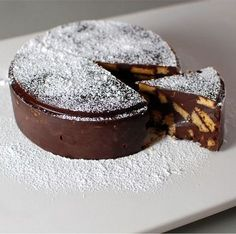 this Vegan Chocolate Biscuit Cake is Royally rich and tasty! Quick and easy, this no bake recipe is perfect for a Royal Wedding Groom's Cake. Cookie Desserts, No Bake Desserts, Just Desserts, Cookie Recipes, Dessert Recipes, Cake Cookies, Cupcake Cakes, Chocolate Biscuit Cake, No Bake Treats