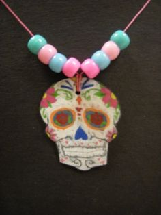 Day of the Dead shrinky dink. Trace from template and color with colored pencils. Punch before baking!