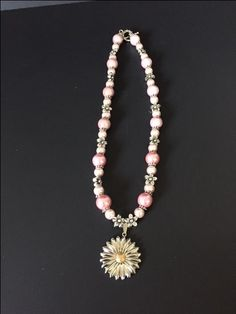 A personal favorite from my Etsy shop https://www.etsy.com/listing/502642603/elegant-pink-necklace