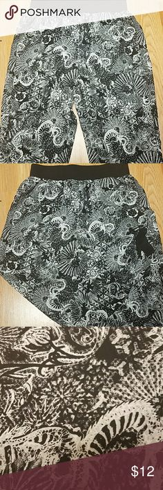 """Gypsy pants Black and white """"gypsy"""" pants. Funky floral print. Banded ankles for a tight fit. Loose fit on legs. Waist band for secure fit. Pockets in both front and back! Body: 100% polyester. Rib: 95% cotton 5% spandex silence + noise Pants Track Pants & Joggers"""