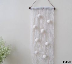 Pompon wall hanging wall hanging pompom decor.
