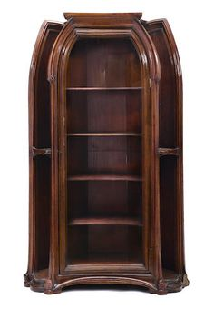 A Louis Majorelle stained carved oak vitrine cabinet circa 1900