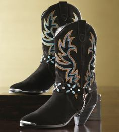 de24200ebf4442 Brilliant turquoise and gold embroidery amplifies the style factor of this  fabulous black suede boot.