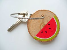 """* * *WATERMELON SLICE* * *  This handmade wooden keychain fob """"Watermelon Slice"""" makes anyone miss the summertime! It's bright red juicy watermelon color is accented by a light green and white rind and black seeds. I hand painted this geometric, color block design on a pine wood tree branch slice. It can be used for your keys, as a zipper pull, or as a backpack or purse accessory."""