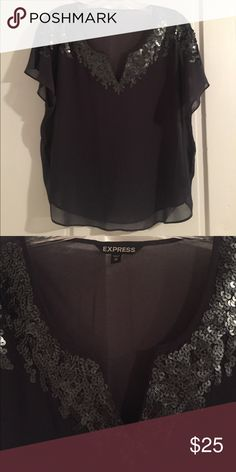 Dark gray, sheer top from Express Dark gray with sequins near the collar. Fits loosely so a dark cami can be worn underneath. Perfect for a night out! Great condition. Express Tops Blouses