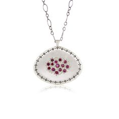 A sterling silver pendant hand set with a cluster of rubies and accented with a Nostalgia etching and star beading.  Each piece of Adel Chefridi jewelry is handcrafted with care. Please allow up to 7 days of studio production time. This time does not include time in transit with the shipping carrier.