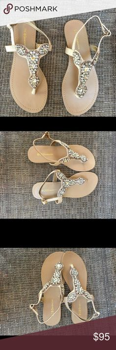 BCBGeneration beige sandals with rhinestones  BCBGeneration beige sandals with rhinestones.  New without tags.  Never worn.  Gorgeous to wear with shorts, skirts or pants.  Perfect color to wear during the day or evening. BCBGeneration Shoes Sandals