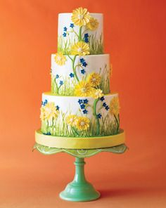 Garden Wedding Cake with Yellow Daisies.  Very pretty cake with bright spring colours on a pretty green jadeite stand.  ᘡղbᘡ
