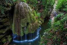 Bigar Waterfall in Nature Reserve, Romania - One look at this waterfall and you'll see why traveling to it is a must. The stream falls from a cliff onto the moss, which makes the water fall in the interesting patterns you see Landscape Wallpapers, Places To Travel, Places To See, Travel Destinations, Wonderful Places, Beautiful Places, Beautiful Scenery, Beautiful Horses, Beautiful Landscapes
