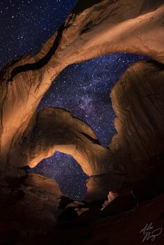 Double Arch, located in Utah's Arches National Park, under the night sky.