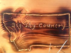 We love our home! Hand carved and burned sign made in Big Sky Country!