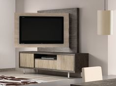Backing designed to pivot with the TV. Also two-toned cabinet. *** Muebles de salon comedor moderno ONA de BaixModuls