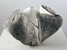 Open-mouthed, pleated shell-shaped container with creamy white interior glaze with center pool of crackled glass glaze and rough, incised exterior , 2013 Glazed stoneware Koike Shôko Ceramic Studio, Ceramic Clay, Slab Ceramics, Wood Stone, Ceramics Projects, Japanese Ceramics, Paperclay, Pottery Designs, Contemporary Ceramics