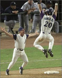 Nov. 7, 2001, Phoenix, AZ, World Series game 7 - New York Yankees ace reliever, Mariano Rivera, serves up bloop single to Diamondbacks Louis Gonzalez to plate the winning run in the bottom of the 9th inning. Gonzalez jumps for joy celebrating with Diamondbacks first base coach Eddie Rodriguez.