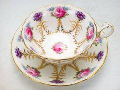 Two of my favorites: roses and violets...Cauldon taeacup 1905